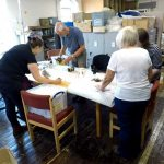 coproduction volunteers working with collections staff auditing items in the collection