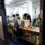 looking into workshop 2 of derby silk mill museum where two coproduction volunteers are making a box